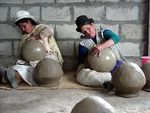 potters forming pots