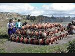 stacking pots for firing by Joe Molinaro