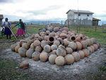 unloading pots after firing by Joe Molinaro